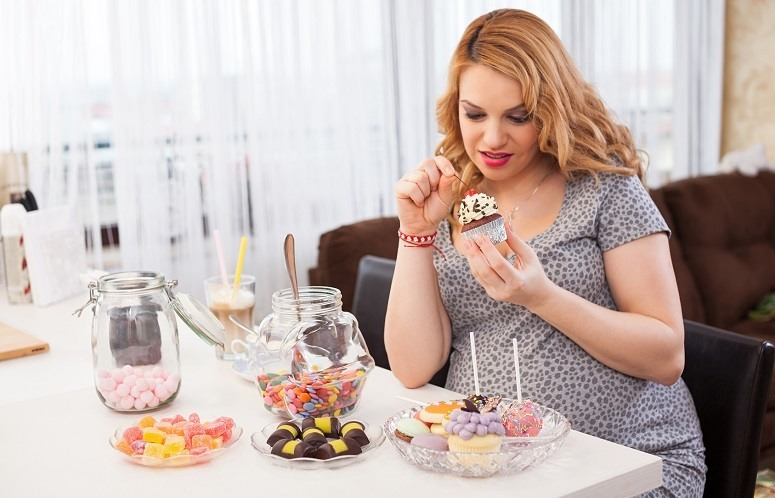 Woman Eating Cakes